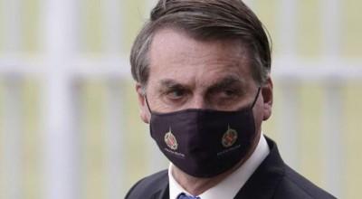 Bolsonaro promete reunião no Ministério da Saúde a mulher que diz ter achado a cura do corona no alho